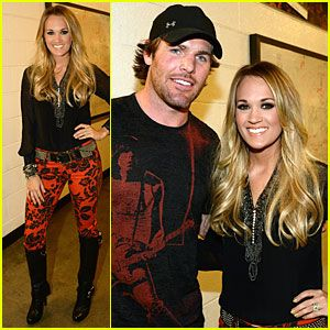 carrie underwood and mike fisher | carrie-underwood-mike-fisher-were-all-4-the-hall-concert.jpg