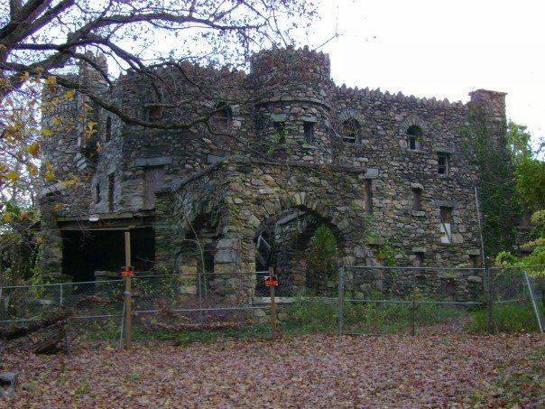 HEARTHSTONE CASTLE  DANBURY, CONNECTICUT Several hauntings are now known to exist on the grounds around the castle. There have been reports of shadowy figures, glowing orbs or mists in the castle's windows or on the roof, as well as the surrounding land and the locations of the former servant houses. Some hikers have reported being pushed  sticks thrown at them.