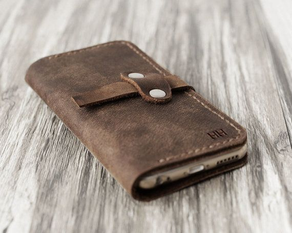 This Iphone 6 Wallet / Case is made from distressed leather and handstitched up by wax thread. It will be aged beautifully over time. It is sturdy, practical and styled with our minimalistic charisma. =======================  SPECIFICATIONS: - Distressed oiled leather, will be aged beautifully over time. - A very thin and clear TPU case is sewed on the leather to protect and hold the phone.QUALITY GUANRENTEE. - Hand stitched with Waxed linen thread, 100% handcrafted, made to order - fit for…