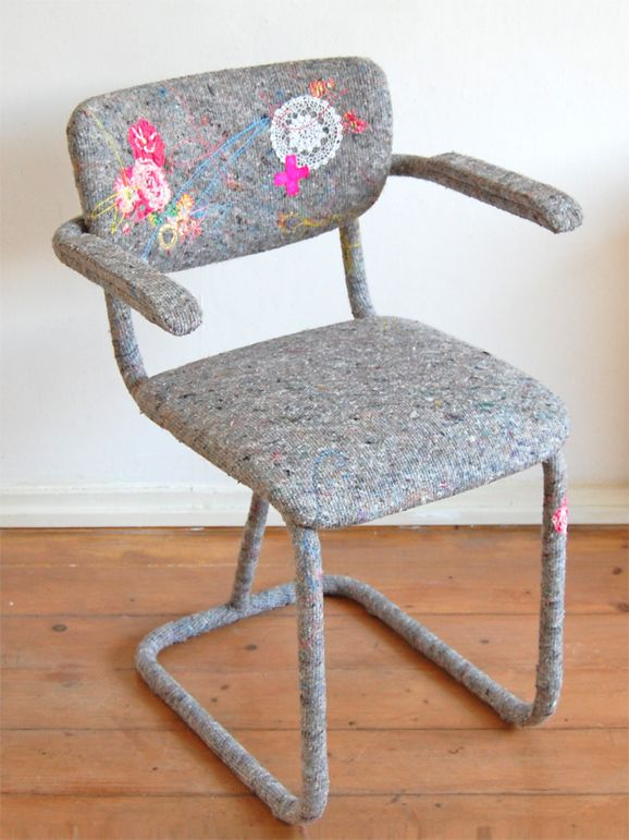 Chair recovered with a packing blanket with spirograph and floral application.