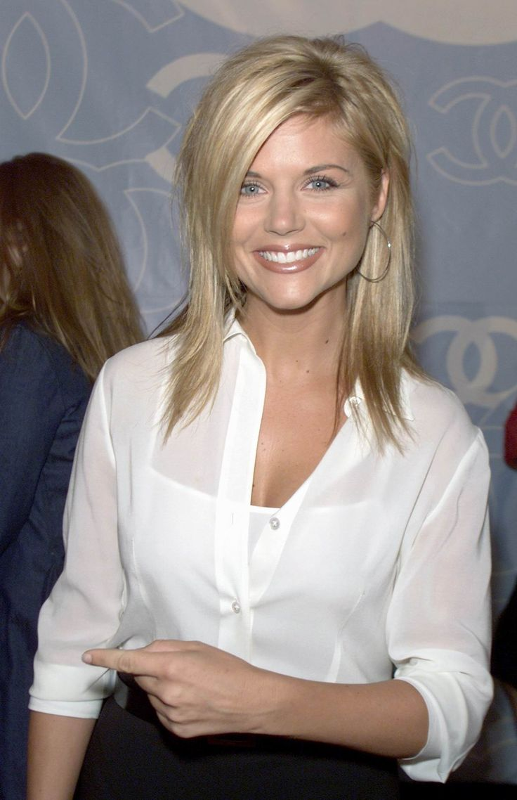 Tiffany Amber Thiessen. I get told that I look like her all the time!