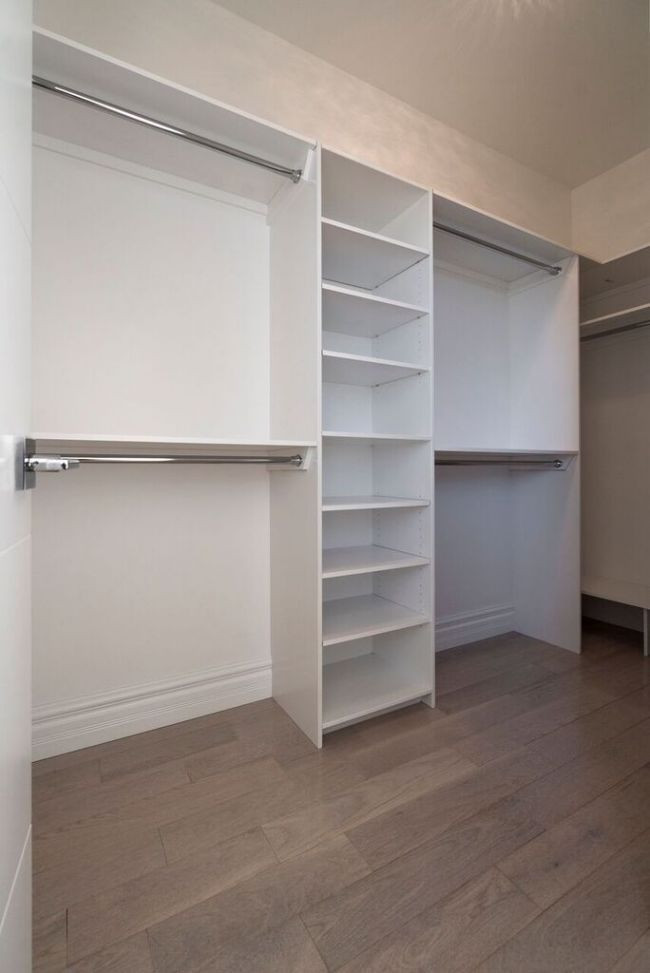 Spacious Closet With Built In Shelves And Two Levels Of
