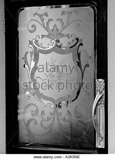 Etched glass in pub door - Stock Image