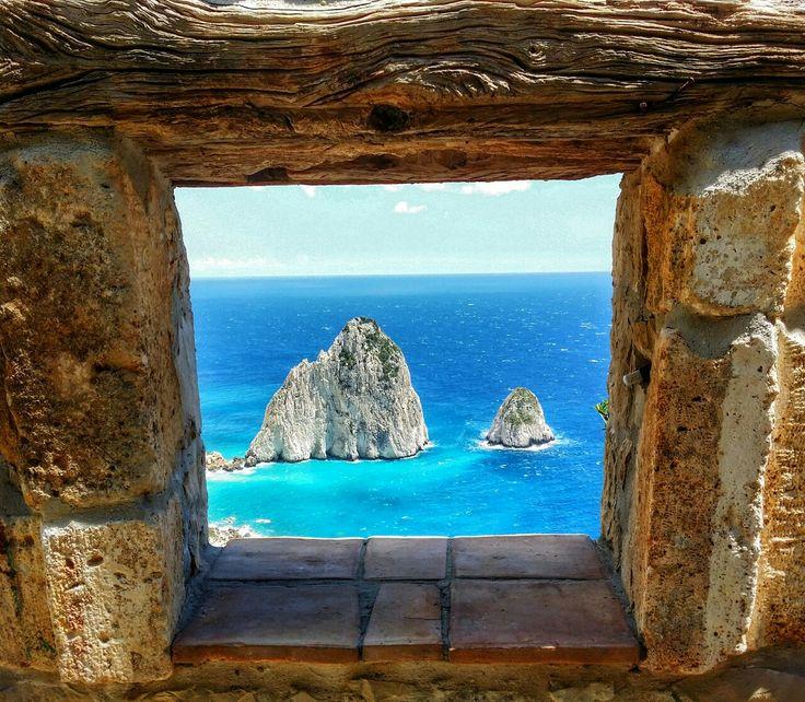 Mizithres Rocks Through The Window. View from the Keri Lighthouse Taverna on Zakynthos island Greece