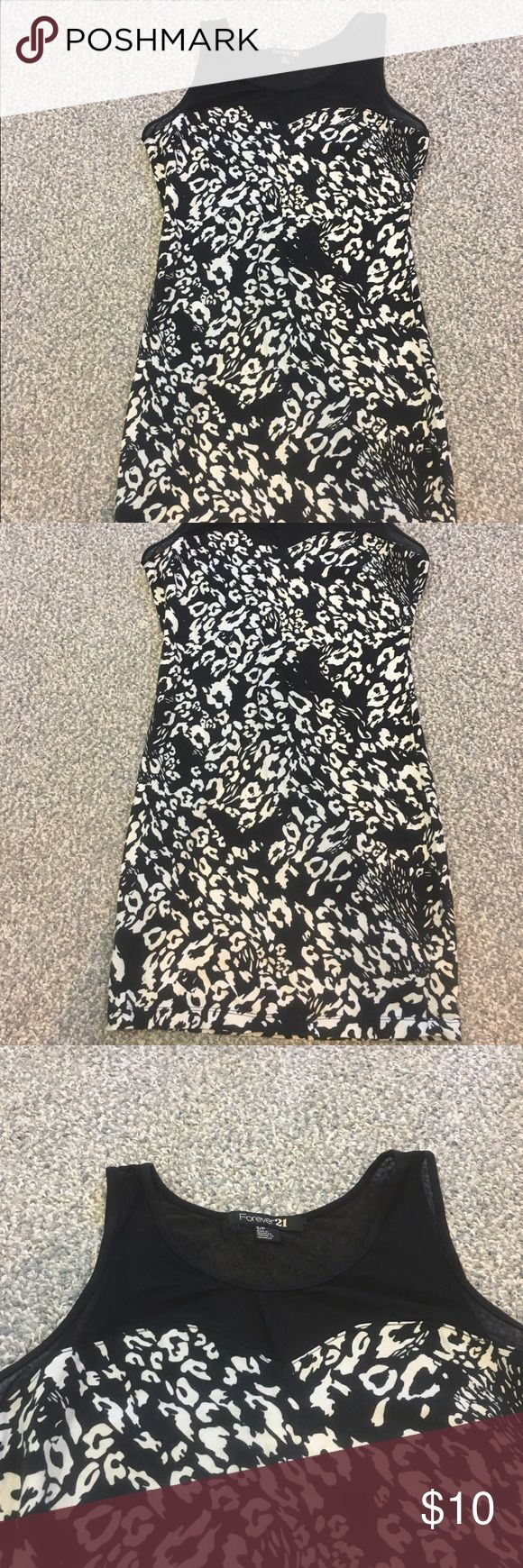 F21 bodycon cheetah print dress Bodycon dress with black and white cheetah print, black mesh at upper chest and neck. Size small. Worn once! Dresses
