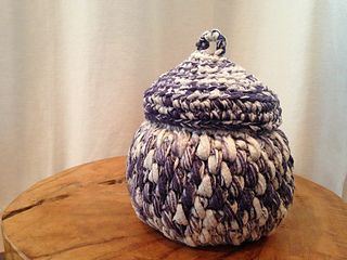 Soft but sturdy little container using only 100 yards of bulky tape yarn and can be accomplished in just one day!