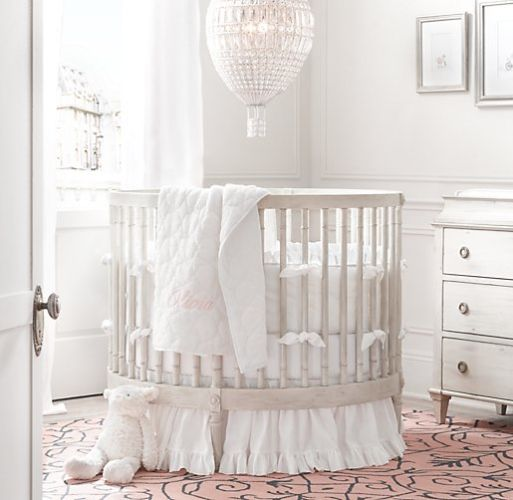 Restoration Hardware 'Ellery Round Round Crib'. I also adore the air balloon!!!