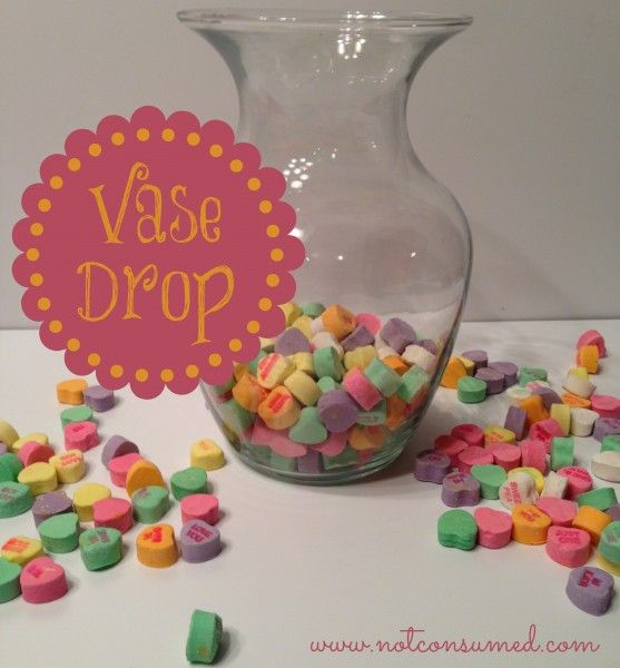 Conversation heart vase drop. How many can you get in? Super fun game for family night or school parties.