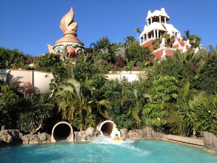 The Giant at Siam Park, Tenerife >    Twin spinning tubes (one moving clockwise, the other counter clockwise) take you on a journey through closed pipes into a sparkling blue pool.