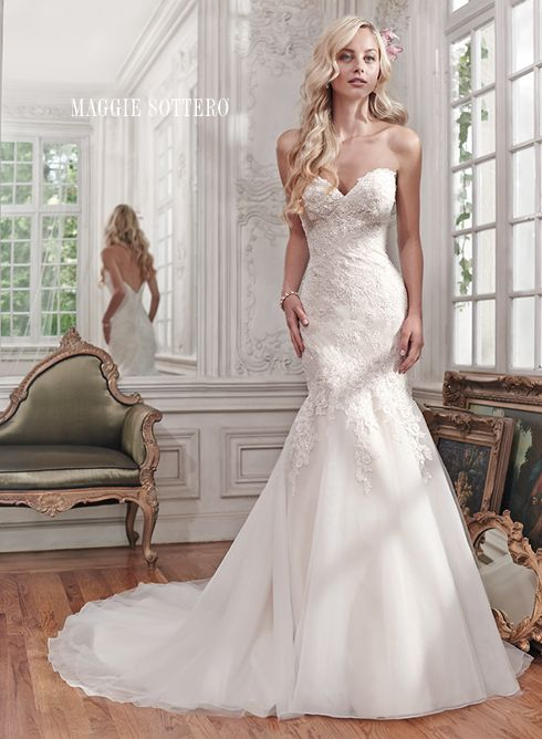Miranda wedding dress by Maggie Sottero | Gorgeous lace and tulle combine to create this stunning fit and flare wedding dress, accented with shimmering beads and a classic sweetheart neckline. Finished with covered buttons over zipper and inner elastic closure.