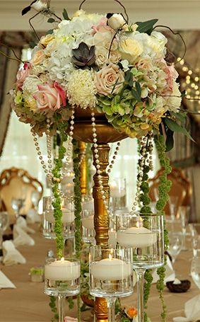 Whimsical floral centerpiece at an enchanted forest inspired reception at Disney's Grand Floridian Resort & Spa
