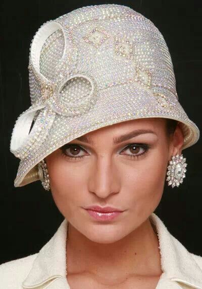 Shellie McDowell Hats. This would be a gorgeous bridal hat (but would omit the big earrings).