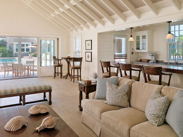 Classic Nantucket Shingled Beach House - Features an open layout, plenty of space for  guests, and natural stone tile flooring which is low-maintenance.