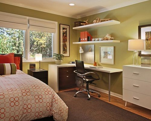 I like the corner desk - short side in front of window?  Cute little bedroom/office combo.  <3