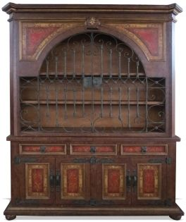 This Traditional Tuscan Bookcase is a custom made piece that was created in Peru using reclaimed and repurposed woods and raw materials. It has a strong masculine build which is decorated with ornate hand forged iron hardware giving this furniture piece balance in both architectural and decorative design.