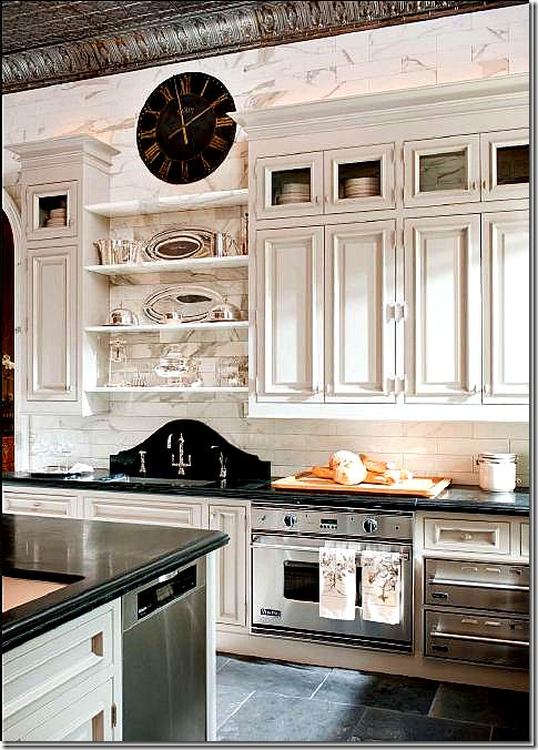 Wow.  This may be the most amazing kitchen I've ever seen.  Tin ceilings, vintage accents, simple, uncluttered.... beautiful.