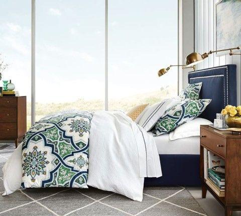 Ashton Organic Duvet & Sham. Pottery Barn. A tile work mosaic of interlocking shapes in rich hues brings depth to this bedding's design.