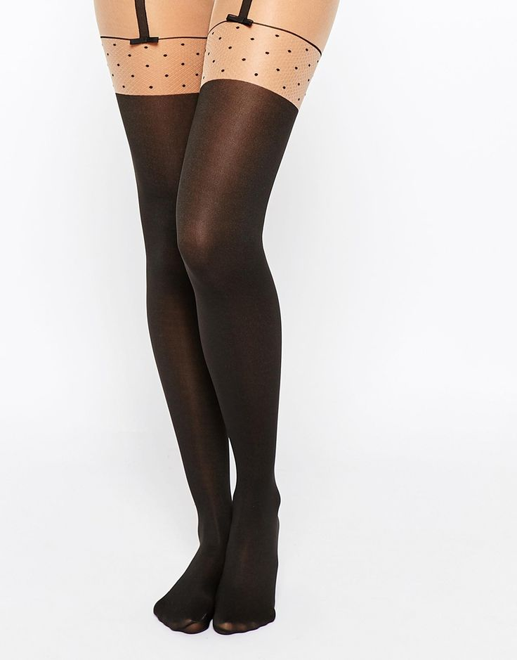 Tights by Wolford Stretch opaque fabric Mock suspender design Patterned, semi sheer inserts Brief panel High-waist Machine wash 61% Polyester, 34% Nylon, 5% Elastane
