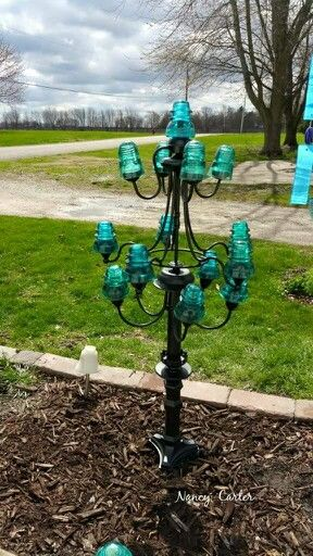 3 chandeliers on lamp base decorated with insulators