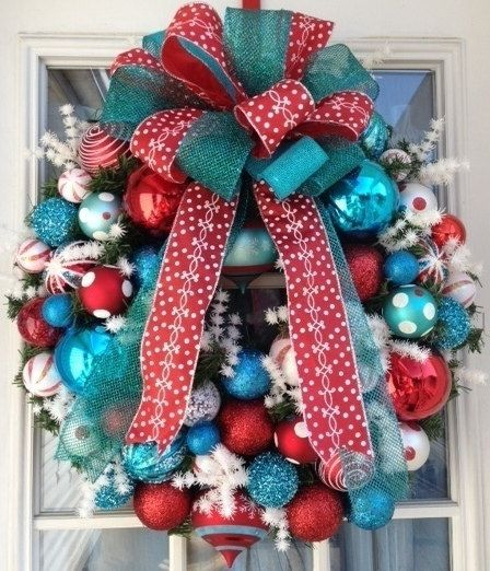 A Spectacular Christmas Holiday Wreath  Beautifully handcrafted Christmas wreath filled with vibrant red, white, and teal ornaments, designer