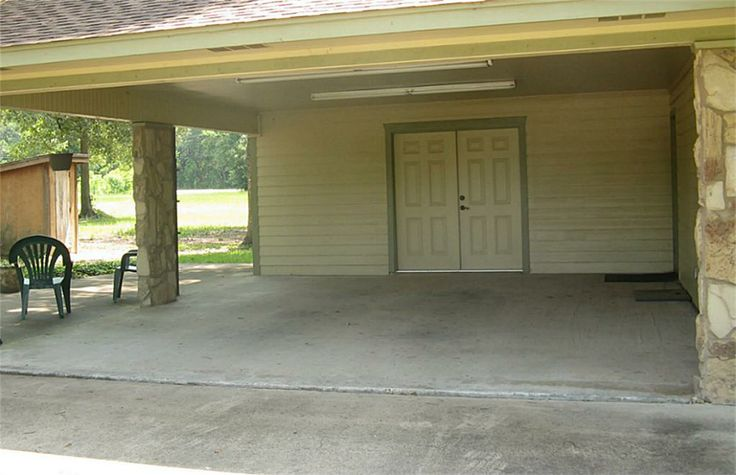 Nice two car carport with storage room attached