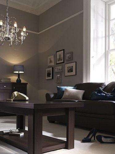 Definitely considering the grey walls with chocolate furniture. Love it.