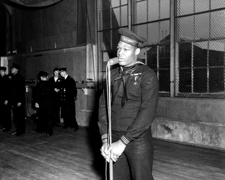 Pearl Harbor hero US Navy Mess Attendant First Class Doris Miller speaking during his war bond tour stop at the Naval Training Station, Great Lakes, Illinois, 7 Jan 1943 (US National Archives)