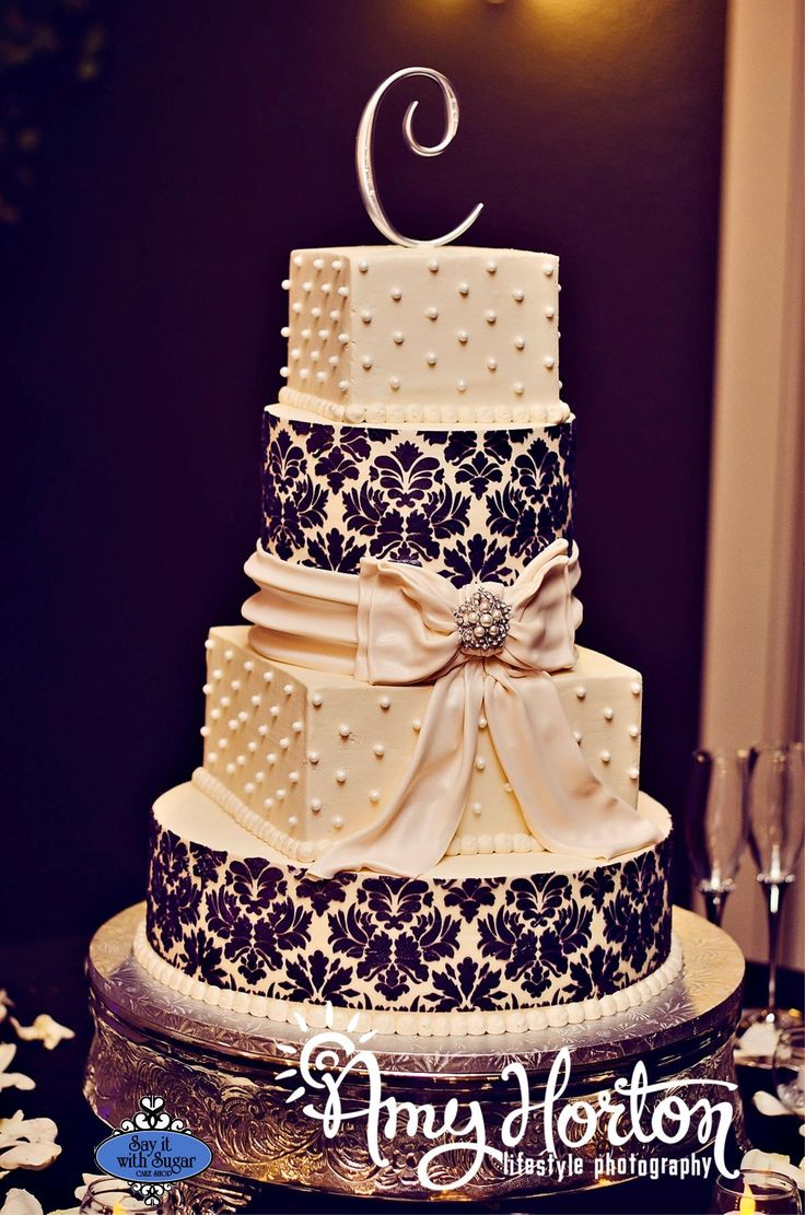 Black, gray, white, and red are our wedding colors...we are incorporating LOTS of pearls too. This cake would be PERFECT.