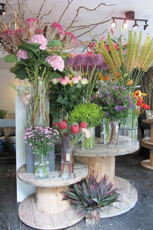 Cable spools as display for flower shop booth (could use for other things as well, of course)