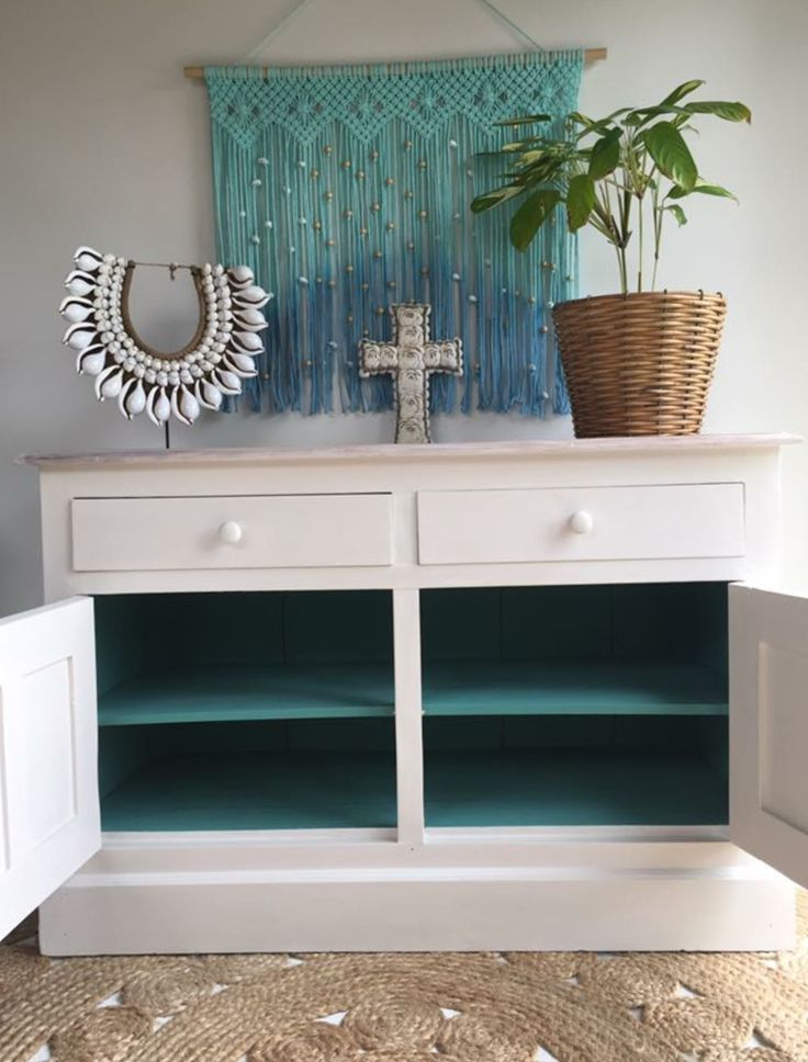 A pop of colour on the inside of the antique sideboard.