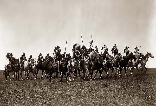 Here we present a rare image of an authentic Brule Indian War Party. It was taken in 1907 by Edward S. Curtis.    The image shows Brule Indians, many wearing war bonnets, on horseback.