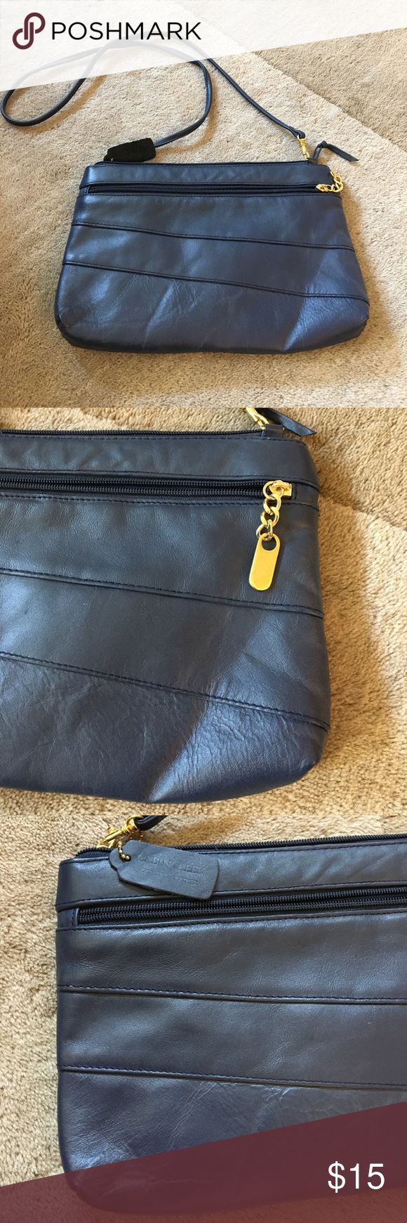 Cabin Creek leather Navy clutch Navy blue clutch, comes with cross body strap. Has zip pockets on front, back, & inside of purse. In good condition! 11 in x 7.5 inches. Genuine Leather. Cabin Creek Bags Clutches & Wristlets