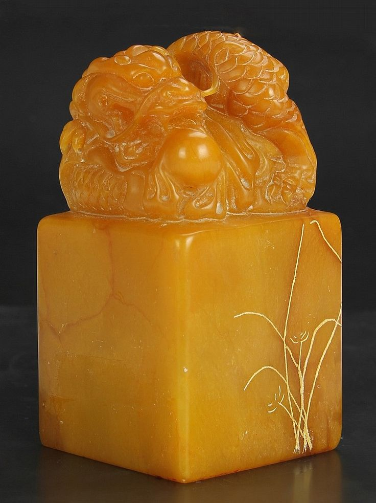 Description: China, 19th C., carved soapstone seal chop in a rectangular form, with detailed dragon figure on the top. Height 4 3/4 in., Width 2 1/2 in., Length 2 1/2 in.