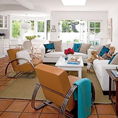 Curvy Modern Chairs Glam Up This Airy Coastal Living Room. Coastalliving.com