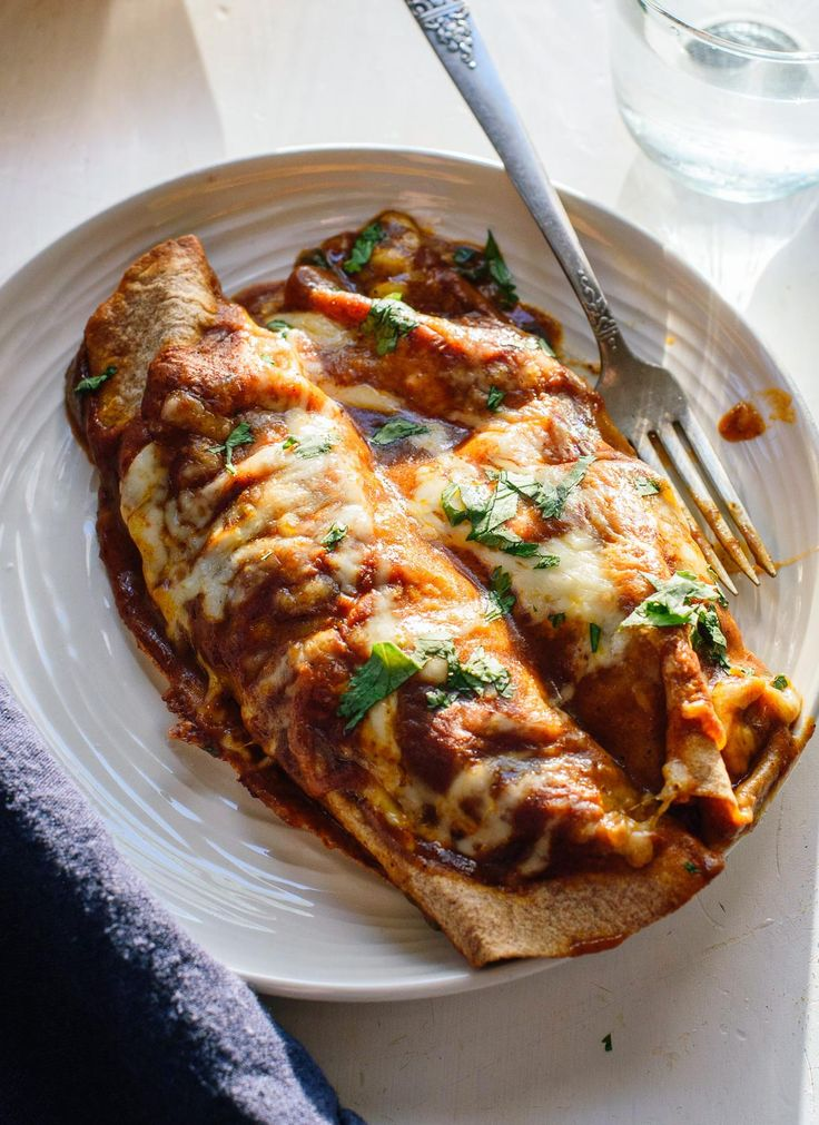 Amazing vegetarian enchiladas stuffed with black beans, broccoli, bell pepper and spinach, topped with homemade red sauce. My favorite enchilada recipe!