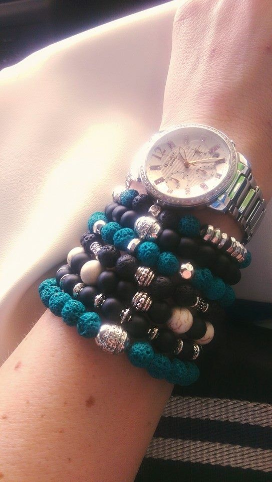 Charm bracelets made with colored lasa stone beads, onix beads and metal charms.