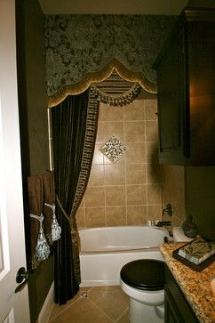 guest bathroom, she wanted an elegant drapery as an alternative to a shower curtain as the shower would rarely be used. We brought down the high ceilings with an oversized valance and carried it to the floor with the soft drapery panel.