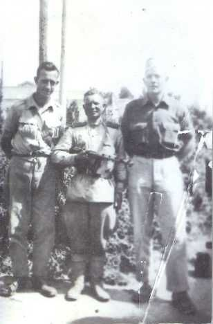 John Minier, a Russian soldier, and John Anderson, another POW, pose for this photo at Mukden, Manchuria u September 1945