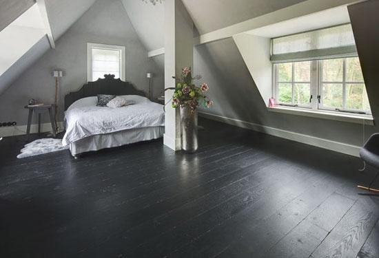 black wooden floor in bedroom
