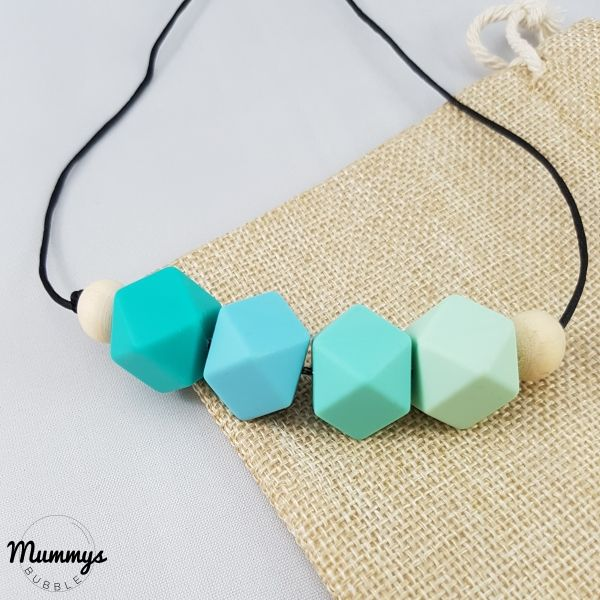 The simplicity yet eye catching combination of silicone beads add a brightness to any outfit. The use of the round wooden against the hexagonal silicone beads breaks the texture and feel for your little baby. The necklace is strung on a strong nylon cord that can be shortened to your preferred length.