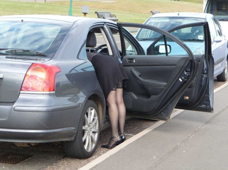 girls bent over cars