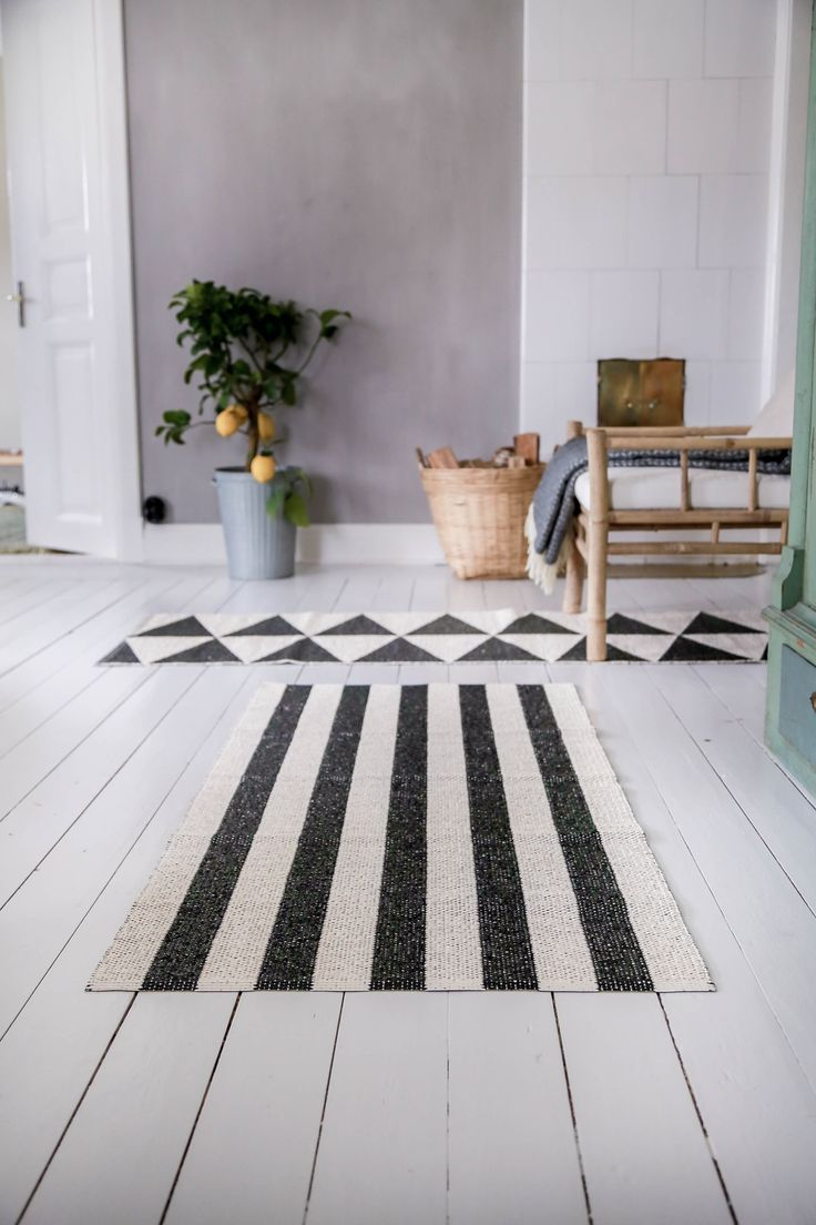 Woods rug and Rime rug in black & white from Nordic Nest. Available in different lenghts. Made in Sweden.