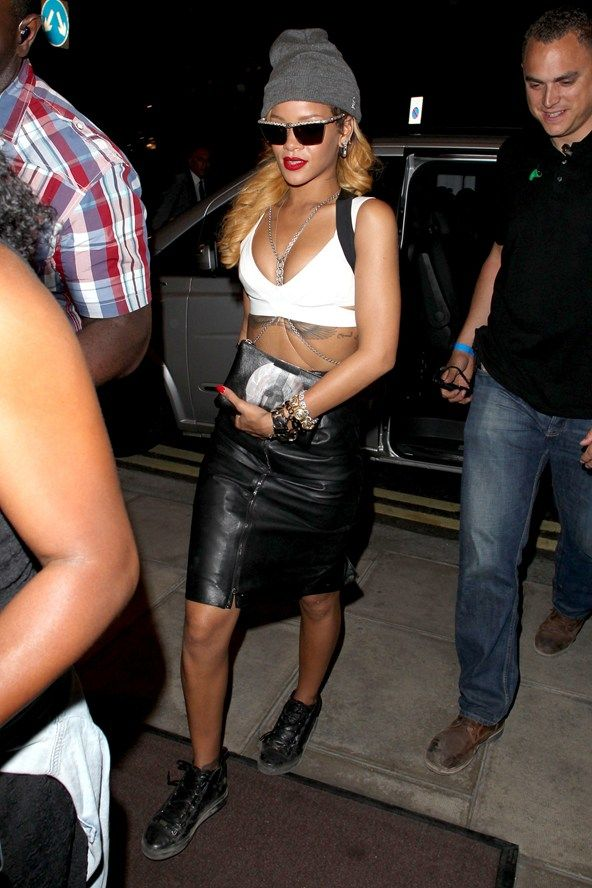 London - July 14 2013 Rihanna joined Jay-Z on stage at Wireless Festival in a Gareth Pugh skirt, accessorised with Balenciaga Arena High trainers, Lanvin sunglasses and a Superbia beanie hat.