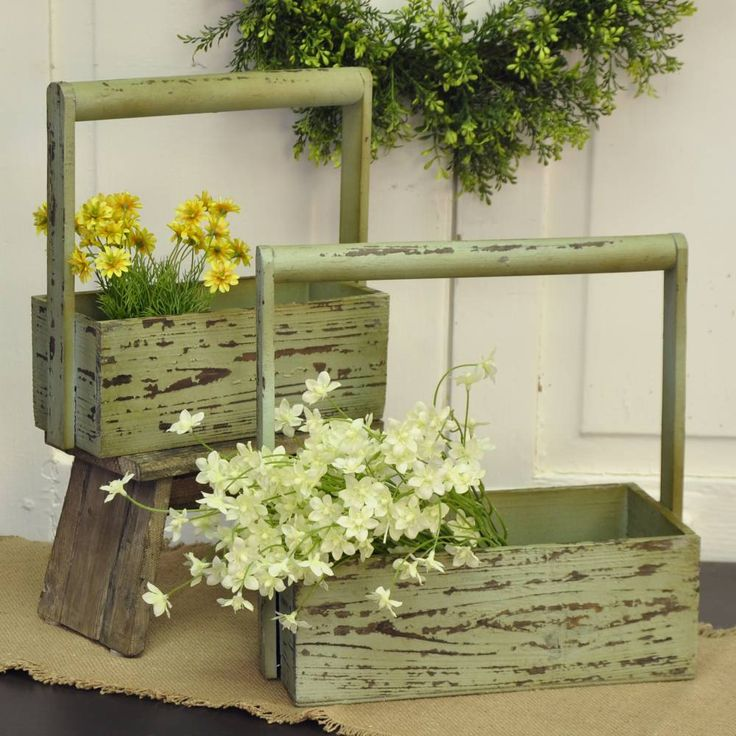 Just like vintage, garden toolboxes, these wooden trugs could certainly be used for lugging around gardening tools or organizing your supply of household tools. However, we think they look best filled with terracotta potted plants, or faux flowers for a beautiful spring time arrangement. They're the perfect addition to your rustic farmhouse spring or summer decor! #farmhouse #decor #box