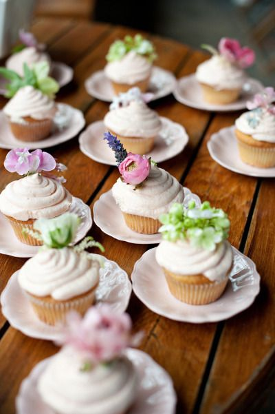 Mix it up with blooms: http://www.stylemepretty.com/2015/03/19/the-prettiest-wedding-cupcakes-ever/
