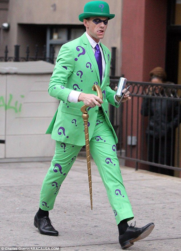 Riddle me this!: Neil donned a spot-on costume of comic baddie The Riddler as he donned a lime green suit with purple question marks emblazoned all over it and a matching bowler hat