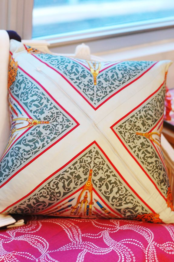 scarf made into throw pillows. corners folded in, sipper sewed in diagonal. genius!