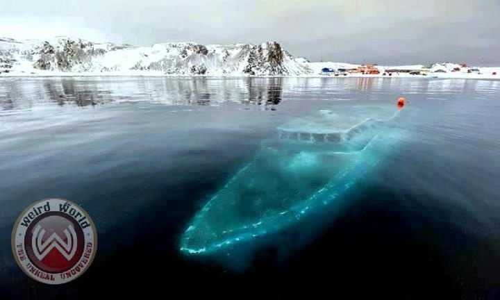 Amazing frosty Antarctic Shipwreck  Resting under the ice water in Antarctica, this unfortunate looks like a ghost ship