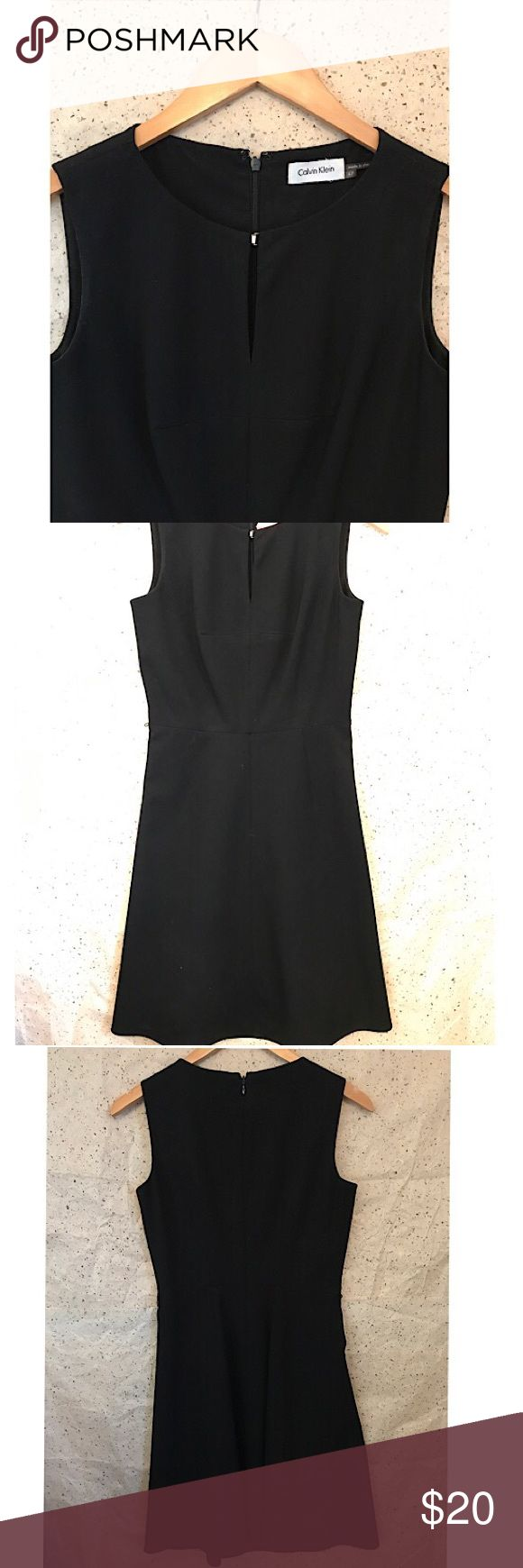 Calvin Klein Black dress In perfect Condition. Size 4 Petite. Black dress perfect for formal or casual wear depending on accessories and style. Perfect for that touch of sophisticated style. In perfect Condition. Front can be clasped closed or open. It's a perfect little black dress. Calvin Klein Dresses