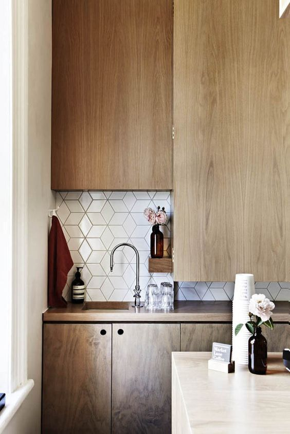 Diamond tiles from Academy Tiles, arranged in a tumbling block pattern, are the perfect touch for a modern kitchen.